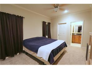 All bedrooms in this lovely home have large walk-in closets and ceiling fans.
