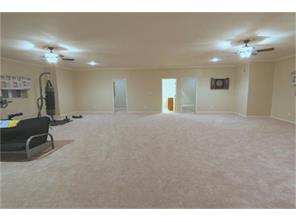 Back thru the Game room with nice plush carpet, lots of windows and dual ceiling fans!