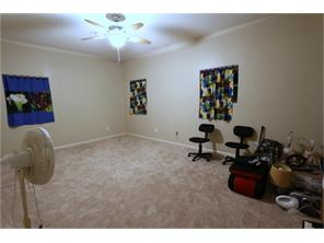 This  room could easily be another bedroom with the addition of a closet or could be your office!