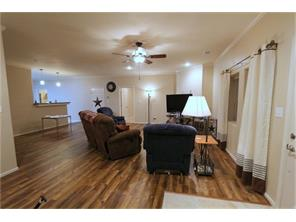 Thru the front door you will find the huge living room with rich laminate flooring