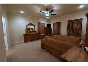 "To the right is the Master Bedroom..  Ceiling Fan to help you sleep peaceful.  All windows have 2"" Faux blinds!"