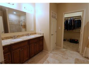Welcome to your own Spa at Home!  Large double sink vanity, linen closet leading to the Awesome Master Closet