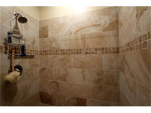 "This shower is large enough for two!  Notice the beautiful tile work.  Beautiful 18"" tile on the floor also!"