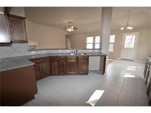 GRANITE COUNTERS, WOOD CABINETRY, SERVING BAR