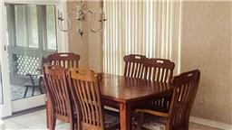 Formal dining is open to living room.