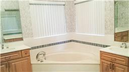 Master bath with double sinks, separate tub and shower.