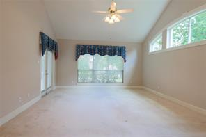 At the other end of the family room is a built-in entertainment unit.  Notice, again, the vaulted ceilings.