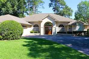 This rare single-story home is located in Bentwater, a gated country club community on Lake Conroe, and situated on the 5-par 7th hole of the Weiskopf course, one of 36 holes of golf to be enjoyed with the available full country club membership.