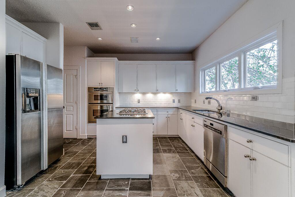 More Than Enough Countertop Space, High Ceilings And Stainless Steel  Appliances.