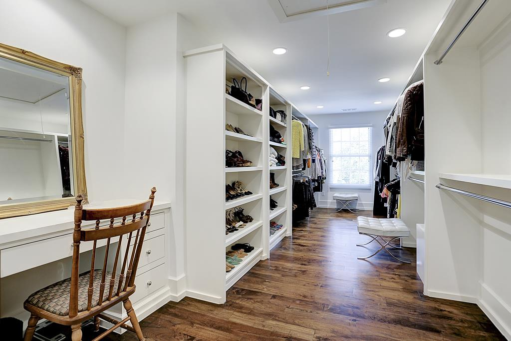 Master closet in Houston home with interiors designed by M Naeve