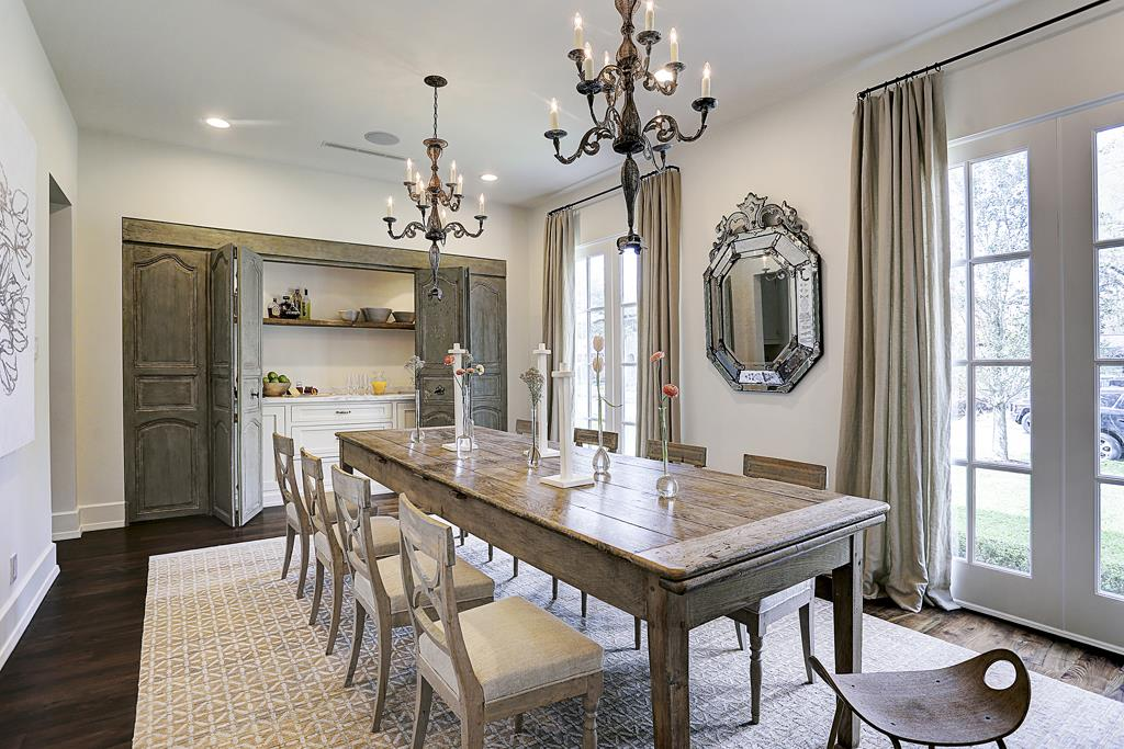 Elegant dining room by M Naeve in a beautiful Houston home with French inspired interiors