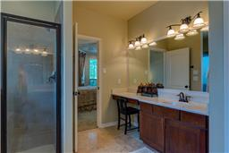 Separate his and hers sinks with vanity area for her.