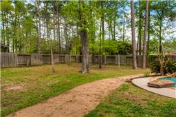 Great trees located in the fenced backyard.  Plenty of play area.