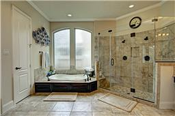 Sunken Jetted Tub and Amazing Shower with Frameless Glass and Two Shower Heads
