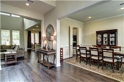 "Formal Dining and 5"" Dark Wood Flooring Throughout"