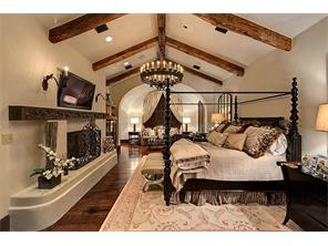 Master Suite - 27 x 14Seclusion and sumptuous luxury are given full rein. Amenities include a wide-plank mesquite floor; vaulted and beamed ceiling; molded plaster fireplace with a rustic beam mantel; and a sitting area overlooking the loggia.