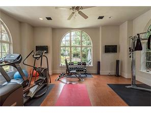 GymThe master wing includes this expansive light-filled gym with a cork floor, mirrored doors and closets, a kitchenette, and windows that overlook the crushed granite bocce court. All exercise equipment is included.