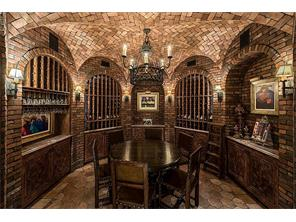 Wine VaultTemperature-controlled and richly appointed for both wine storage and elegant, intimate entertaining. Brick groin-vaulted ceiling; antique Italian tile floor; built-in tasting cabinets.