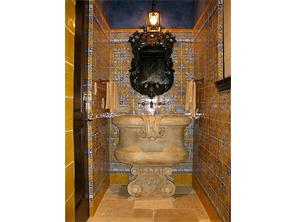 Second Powder Room Italian majolica tile wall; antique marble font sink; honed limestone floor.