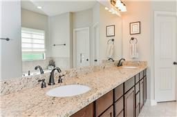 Double sinks, granite counters and lots of storage!
