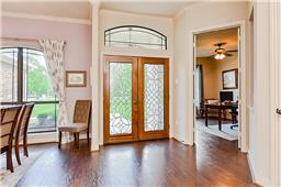 Entry is nice and bright with 10-12 foot ceilings.