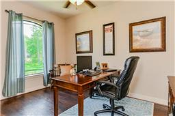 Private office over looks the lush landscaped yard.