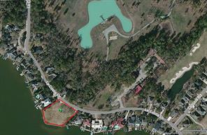 This RED LINE tract is of the approximately 1 ACRE LOT facing Lake Conroe.