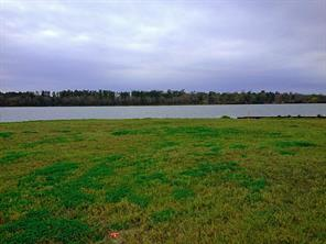 This is a view of the LOT that fronts on LAKE CONROE.  This site is bulkheaded, level, and ready for construction.