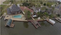 Lake front home is complete with your own private boat ramp, pool, and dock.