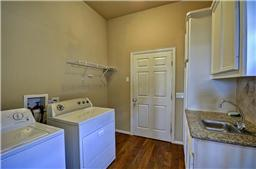 Utility room with plenty of space and includes sink area.