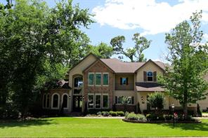 Located in the gated, counrty-club community of Bentwater on Lake Conroe, this home overlooks the 10th green of the Miller course, just one of 36 holes available at the country club.  Exclusive Grand Pines Membership also available.