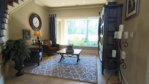 This room sits just to the right of the office/study and, as with most rooms in this home, offers a full view of the golf course.