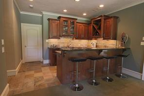 Full wet bar.  Just add a toaster oven and have a fully functional upper kitchen area.  Ideal for visiting guests or multi-generational living.