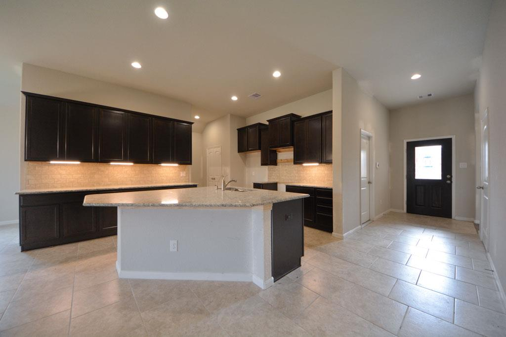 Gourmet Kitchen Has Tall Cabinets With Under Mount Lighting Below Them Tile Back Splash Laid In An Upgraded Patternthis P O Is A Representation Of The