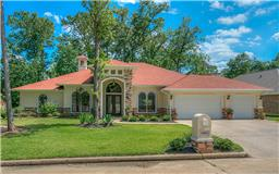 Exceptional one story custom home on TWO lots.