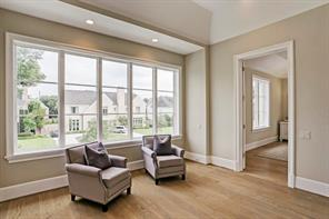 [Master Suite - Morning Room]The height of luxury: a morning room adjoining the master bedroom. Note tray ceiling, wide window, and hardwood floor.