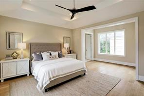 [Master Bedroom 22 x16 ]Serene master bedroom offers a tray ceiling and hardwood floor.