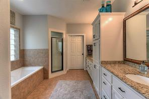 Dual vanity, whirlpool tub, separate shower, and tons of storage in master bathroom.  His and hers vanities are varying heights for comfort.