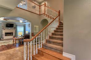 The foyer has FOUR closets and a sweeping staircase.
