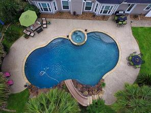 The pool boasts 2 rock waterfalls, grotto, slide, hot tub, sun deck, and a 10 foot deep end.  There is a full bathroom for easy access!