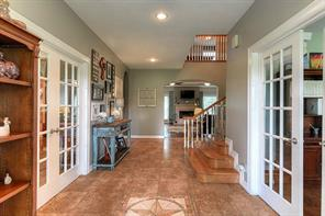 Large foyer to greet your guests. Office is on the right, Formal dining is on the left. Living room and kitchen ahead.