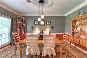 Host holiday dinners in the dining room that has French doors, chair molding, and art niches.
