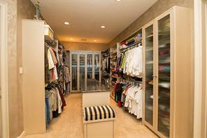 If you like space for your personal possessions, this master closet has it and then some.