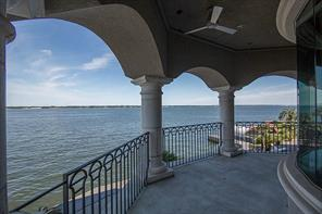 And when the home owner wants alone time, the private 2nd floor covered balcony is the perfect spot. So tranquil and relaxing.  Oh, and look at the views!  You can see south down to the dam and east across the full width of Lake Conroe.