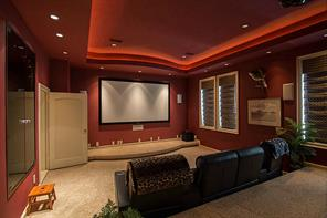 "This is the Media Room with wet bar is a recent addition. What a great place for your guests to have a little ""down time"" to watch a ballgame or favorite movie.  Where s the popcorn?"