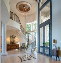 Built by Rocky Butler of Tuscany Homes, the home has a very open floor plan with a double-height foyer with barrel ceiling. Exquisite attention to detail is clearly visible in each and every room.