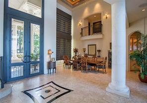 To the left of the entry doors is the impressive two-story formal dining room.  The Juliette balcony above leads to the Media Room.  The Butler s Pantry connects with the Kitchen for easy service.