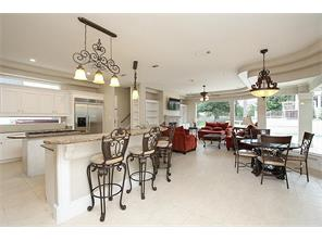 Chef s kitchen opens to your large living room and breakfast area featuring panoramic views of the backyard.