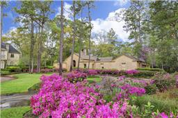 Incredible trees, azaleas and gardens surround the property.