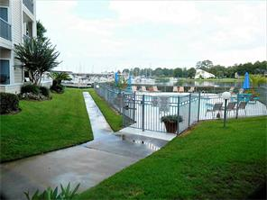 Enjoy summer days with easy access to the pool and view of the marina!